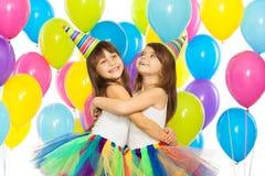 生日聚会的两个小女孩 库存图片