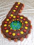 生日蛋糕塑造了象第六 库存照片