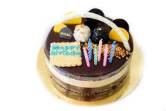 生日蛋糕,吹灭在生日巧克力蛋糕的蜡烛 图库摄影