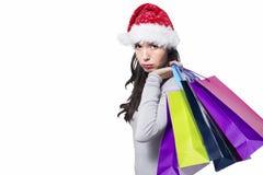 生气俏丽的女孩,当圣诞节购物时 库存图片
