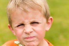 生气的新男孩 免版税库存照片