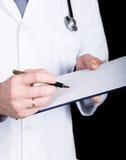 医生的特写镜头手,他采取在患者的病史的笔记 库存照片