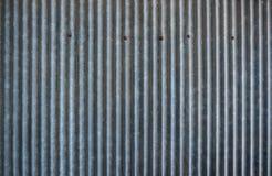 生锈的波纹状的金属纹理 免版税库存图片
