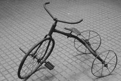 生锈的玩具自行车 免版税库存图片