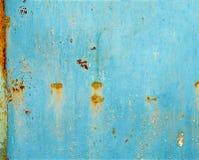 生锈的被绘的金属背景或纹理 免版税库存图片