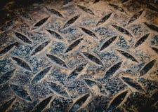 生锈的金刚石黑色金属背景 库存照片