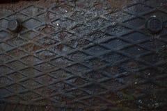 生锈的金属有螺丝纹理背景 免版税库存照片