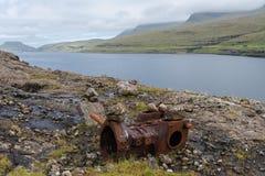 生锈的金属零件,放弃由在法罗群岛的路 免版税库存照片