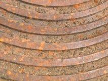 生锈的钢人孔盖 免版税库存图片