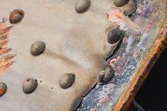 生锈的钢和铆钉细节 库存照片