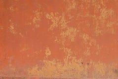 生锈的铁表面与老油漆残余的,红色纹理,背景 库存图片