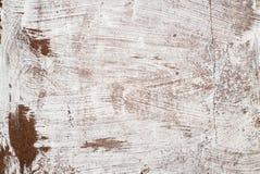 生锈的铁绘与白色油漆 图库摄影