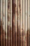 生锈的锌篱芭 免版税库存照片