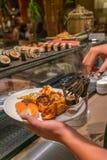 生鱼片寿司,烤龙虾盘  库存照片