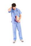 医生:感觉男性的护士疲倦 免版税图库摄影