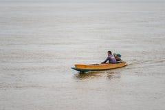 生活亚裔渔夫和渔船 库存图片