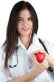 年轻医生With Stethoscope Gently Holds心脏 免版税库存照片