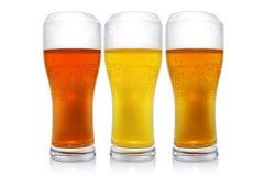 用不同的啤酒的三块玻璃 库存图片