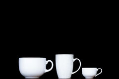用不同的形状的三个白色杯子 库存图片