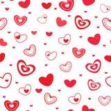 用不同的红色心脏的无缝的样式 图库摄影