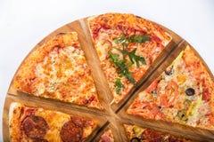 用不同的装填的被分类的薄饼在一个木盛肉盘 免版税库存图片