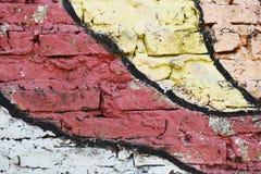 用不同的颜色绘的砖墙 免版税库存照片