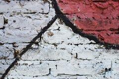 用不同的颜色绘的砖墙 免版税库存图片