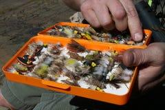 用假蝇钓鱼通话盒 免版税库存图片