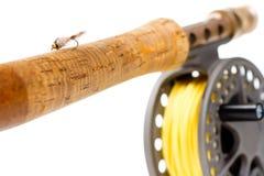 用假蝇钓鱼齿轮标尺和卷轴 图库摄影