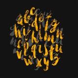 用刷子树荫和s做的手拉的金水彩字母表 图库摄影
