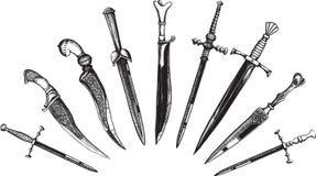 用匕首刺欧洲东方人集 免版税库存照片