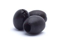 用卤汁泡的黑色挖坑的橄榄 库存图片