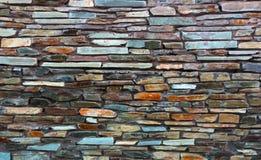 用多块石头做的艺术性的墙壁的片段 库存照片