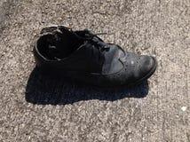 用完穿上鞋子 免版税库存图片