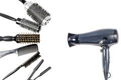 用工具加工在白色孤立的美发师` s顶视图 库存图片