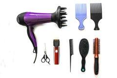 用工具加工美发师剪头发 免版税库存图片