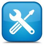 用工具加工象特别深蓝蓝色方形的按钮 免版税库存图片
