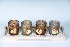用心脏装饰的4个烛台 免版税库存图片