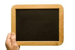 用手举行的小老空白的黑板 免版税库存照片