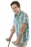 用拐杖支持少年 免版税图库摄影