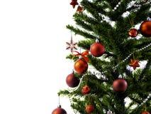 用星装饰的大圣诞树和美丽的红色球庆祝节日 库存图片