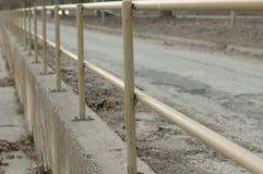 用栏杆围在街道上-透视图 库存图片