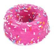 用桃红色结霜涂的多福饼和洒另外col 免版税库存照片