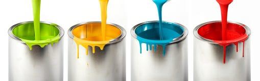 用桶提五颜六色的油漆 免版税库存照片