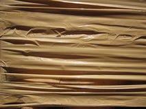 用棕色包裹磁带完全报道的背景 图库摄影