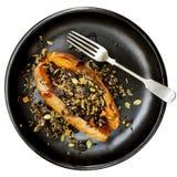 用水菰种子和蔓越桔充塞的被烘烤的白薯 图库摄影