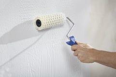 用油漆和膏药创造墙壁 免版税图库摄影