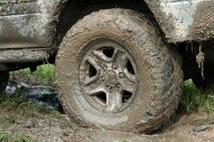 用泥盖的轮子 库存照片