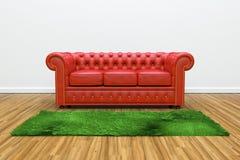 用皮革包盖红色沙发 库存图片