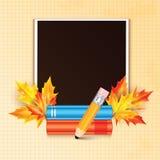 用秋天槭树装饰的照片框架离开和学校 免版税库存图片